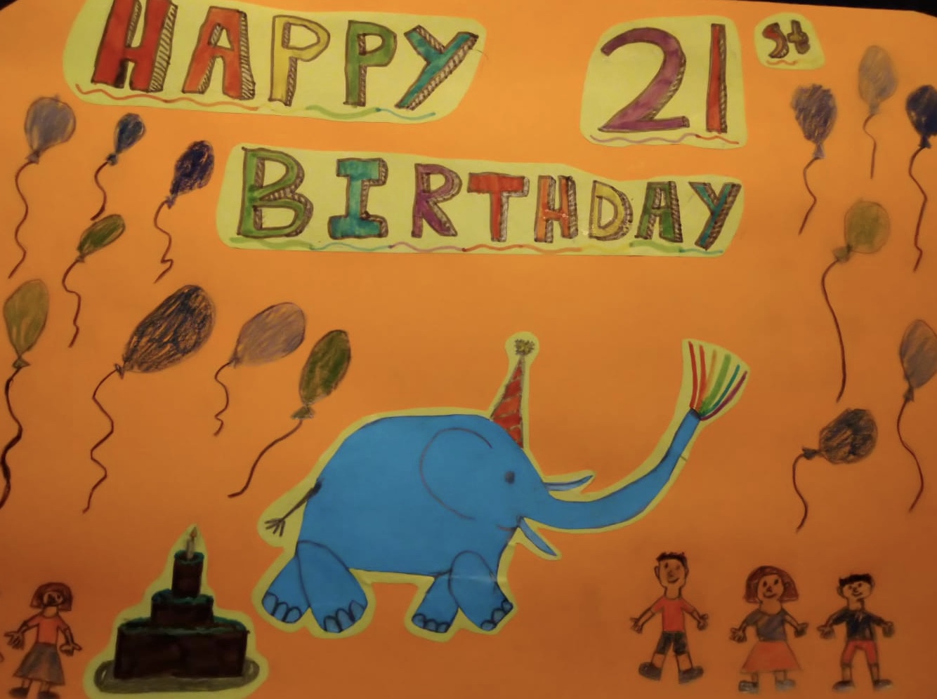 Under 10's entry reading Happy 21st Birthday, with a blue elephant on an orange background