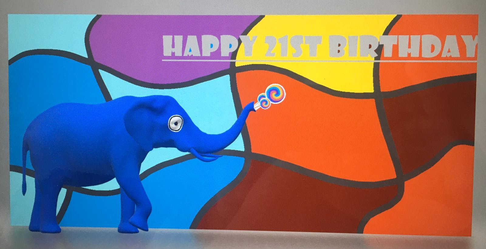 Digital entry reading Happy 21st Birthday with a image of an elephant coloured blue on the left hand side